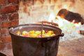 Potato casserole tasty fireplace as background Royalty Free Stock Photos