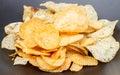 Potato chip on black dish