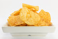 Potato chips barbecue flavour on white background Royalty Free Stock Photos