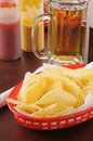 Potato chips and beer Stock Photos