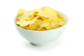 Potato chips in bowl isolated on white background Royalty Free Stock Photo