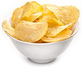 Potato chips in a bowl on white background Stock Photos