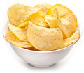 Potato chips in a bowl on white background Royalty Free Stock Photography