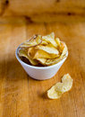 Potato chips bowl on wooden background Stock Image