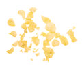 Potato chips crumbs and leftovers isolated over the white background Royalty Free Stock Photo