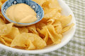 Potato chips and dip dip placed in bowl full of Stock Image