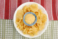 Potato chips and dip dip placed in bowl full of Stock Photo