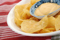 Potato chips and dip dip placed in bowl full of Stock Images