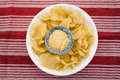 Potato chips and dip placed on red mat Royalty Free Stock Photography
