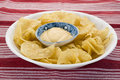 Potato chips and dip placed on red mat Stock Photo