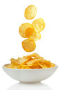 Potato chips falling bowl Royalty Free Stock Photo