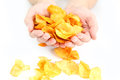 Potato chips in the hands of man Stock Photography