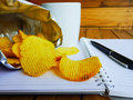 Potato chips snack with work junkfood Stock Photo