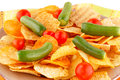 Potato chips and vegetables on plate Stock Photos