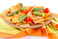 Potato chips and vegetables on plate kitchen towel Stock Image