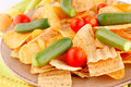 Potato chips and vegetables on plate kitchen towel Royalty Free Stock Photos