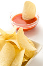 Potato chips in a white bowl Royalty Free Stock Photo