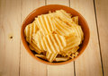 Potato chips on wood Royalty Free Stock Photo
