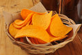 Potato crisps a basket of cheese flavored and bottles of beer Royalty Free Stock Photos