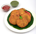 Potato cutlets served along with tomato sauce and mint chutney part of awadhi and hyderabadi mughlai cuisine Stock Photos