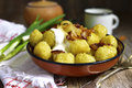 Potato dumplings traditional dish of belorussian and polish cu with fried onion bacon cuisine on rustic background Stock Images