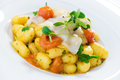 Potato gnocchi with lardo on white Royalty Free Stock Images