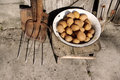 Potato in an iron old bowl, shovel and pitchfork Royalty Free Stock Photo