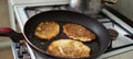 Potato pancakes example of polish cuisine frying in a pan Stock Photos