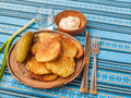 Potato pancakes potato flapjacks and a glass of vodka the traditional ukrainian cuisine on the embroidered tablecloth Stock Photo