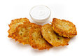 Potato pancakes with sour cream on a white background Stock Image