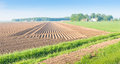 Potato ridges in different directions landscape with a large field with of earth with planted potatoes several Stock Photography