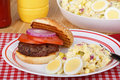 Potato Salad and Burger Stock Photography