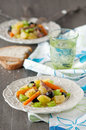 Potato salad with carrot celery olive and anchovy Stock Image