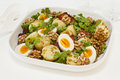Potato salad with egg and lentils warm parsley bacon walnuts caramelised onion mustard Stock Photo