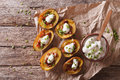 potato skins with cheese, bacon and sour cream on the table. Horizontal top view Royalty Free Stock Photo