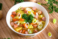Potato soup with fresh leeks and sausage Stock Image