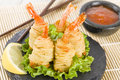 Potato string prawns asian style king wrapped in and deep fried served with sweet chili sauce and lemon wedges Royalty Free Stock Photos