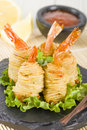 Potato string prawns asian style king wrapped in and deep fried served with sweet chili sauce and lemon wedges Royalty Free Stock Image