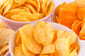 Potato and wheat chips in bowls on gray background Royalty Free Stock Photos