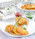 Potatoe pancakes with three dips Royalty Free Stock Image