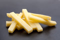 Potatoe stick vegetable closeup on dark background Stock Photography