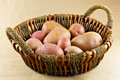 Potatoes in basket a closeup of a on b brown paper background Royalty Free Stock Photography