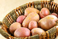 Potatoes in basket a closeup of a on b brown paper background Stock Photo