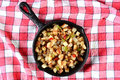 Potatoes Obrien in Skillet on Red Checked Table Cloth Royalty Free Stock Photo