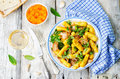 Potatoes pumpkin gnocchi with bacon, cilantro and mint