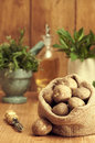 Potatoes sack of with mint leaves in the background Royalty Free Stock Photography