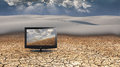 Potential flat panel with fields of grain in desert Stock Photo