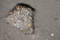 Pothole with gravel on damaged urban road asphalt Royalty Free Stock Photo