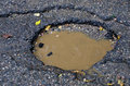 pothole in road Royalty Free Stock Photo