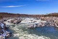 Potomac river in winter at great falls national park virginia landscape of the raging as it cascades over snow capped rocks and Royalty Free Stock Photo